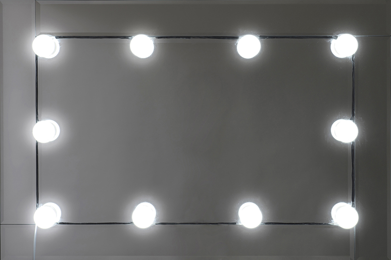 Mirror with lights around it