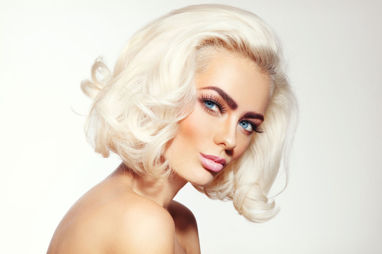 All-out volume in platinum Mid length hairstyle