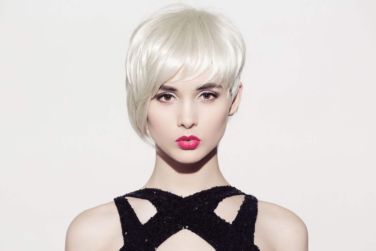 Asymmetric ice blonde textured short bob haircut