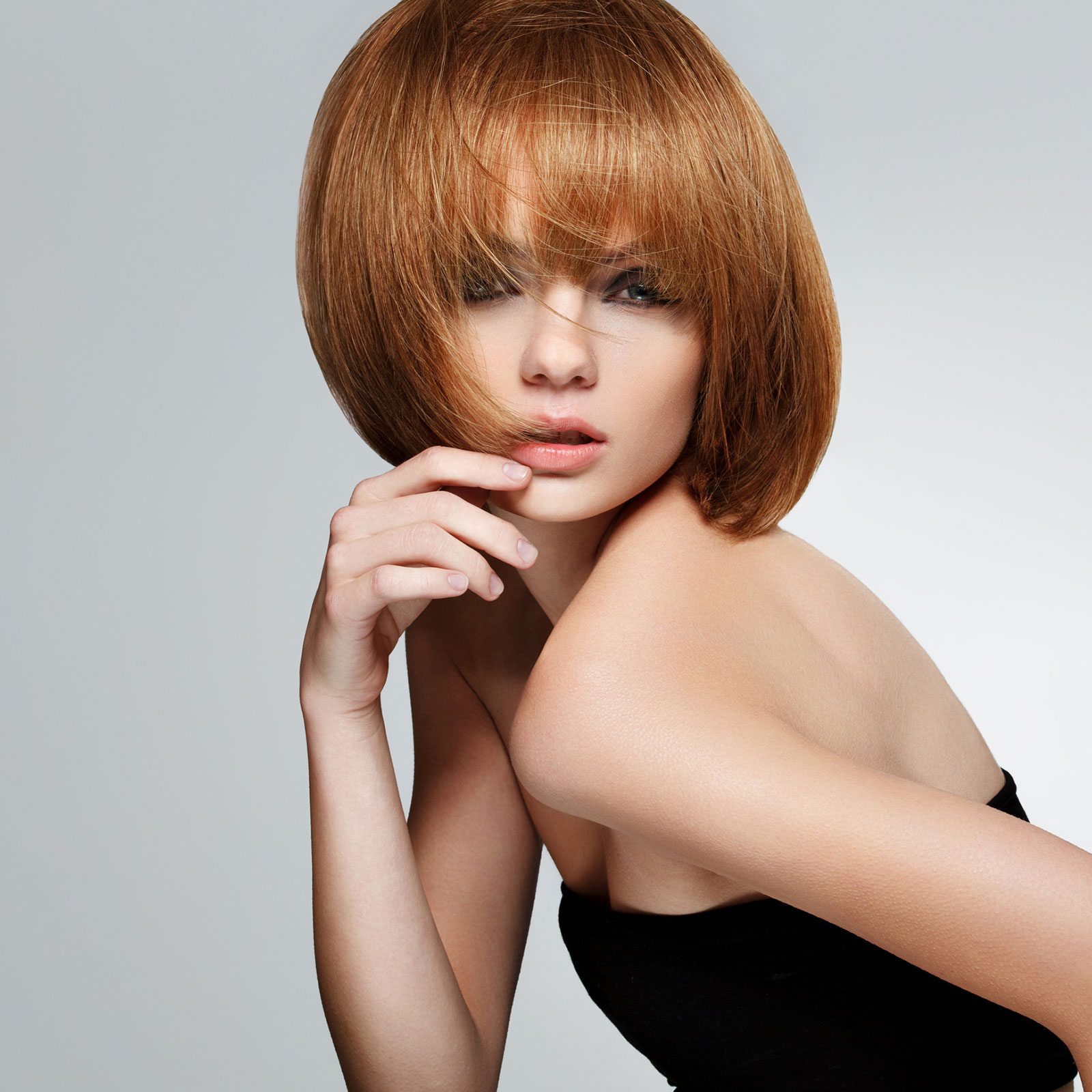 Chinese red bob haircut with wispy fringe