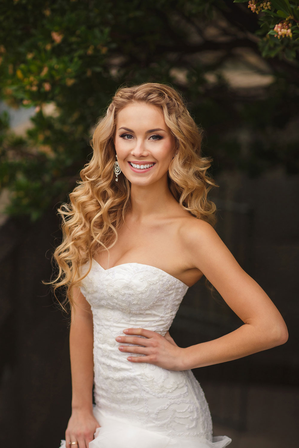 Long and curly with a French plait Bridal Hairstyle