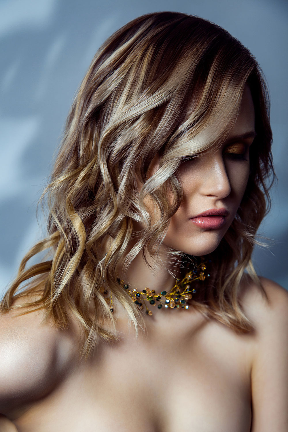 Loose natural waves mid length hairstyle