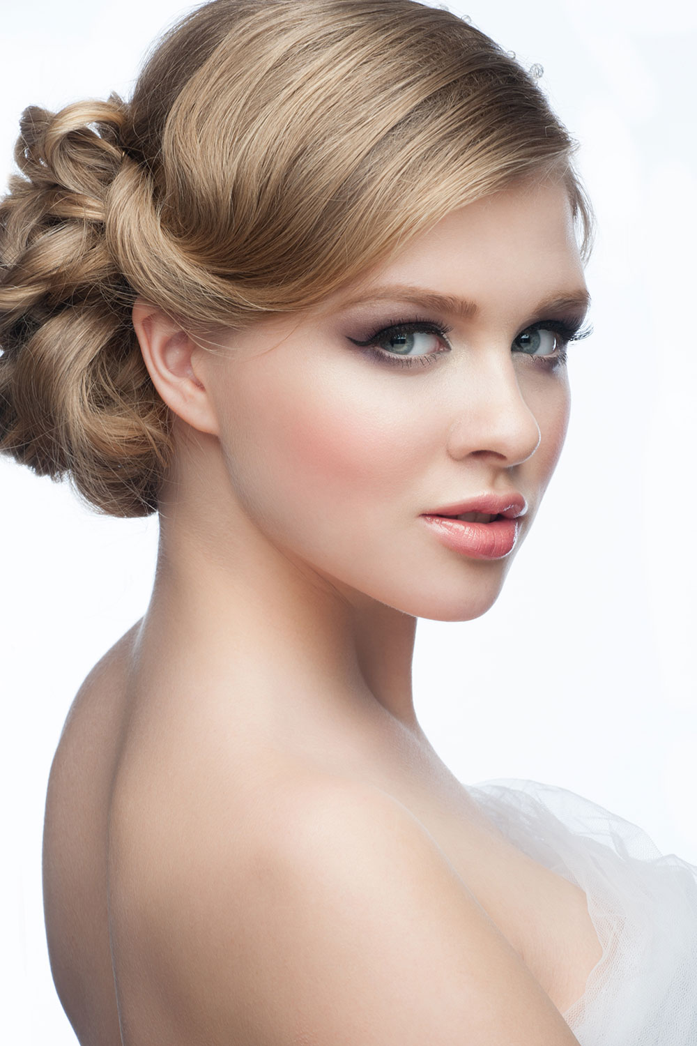 Neat side parted plaited bun Bridal hairstyle