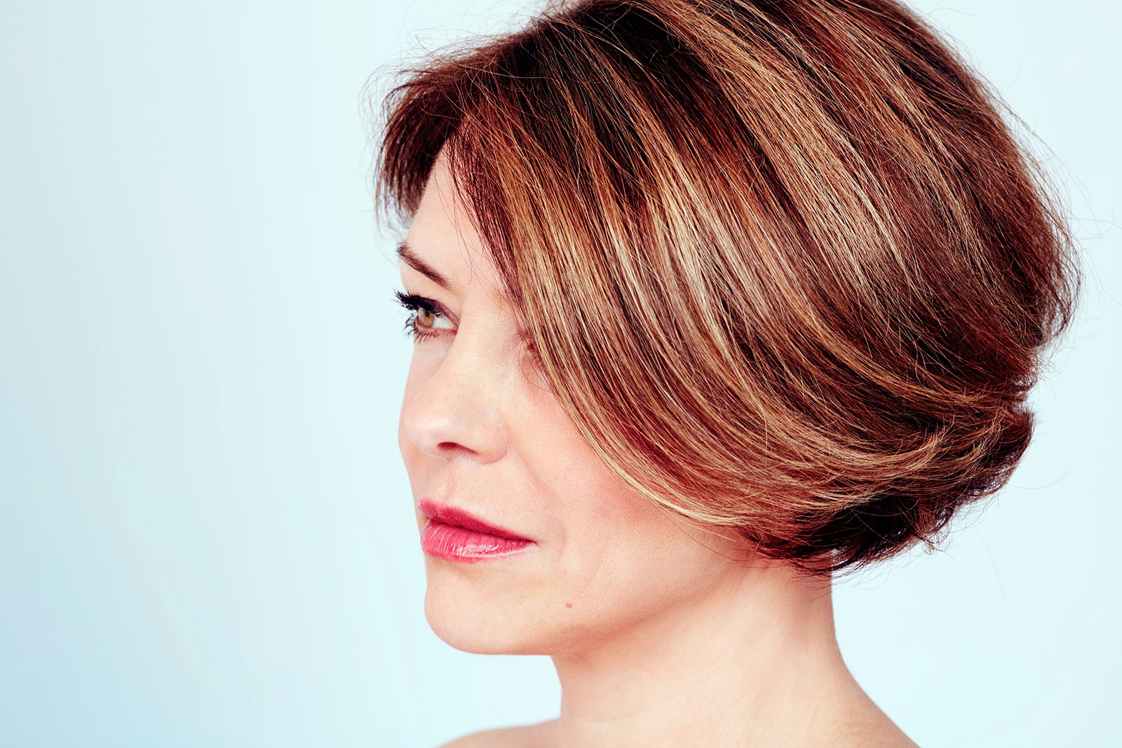 Side-parted bob with back swept layers and soft balayage