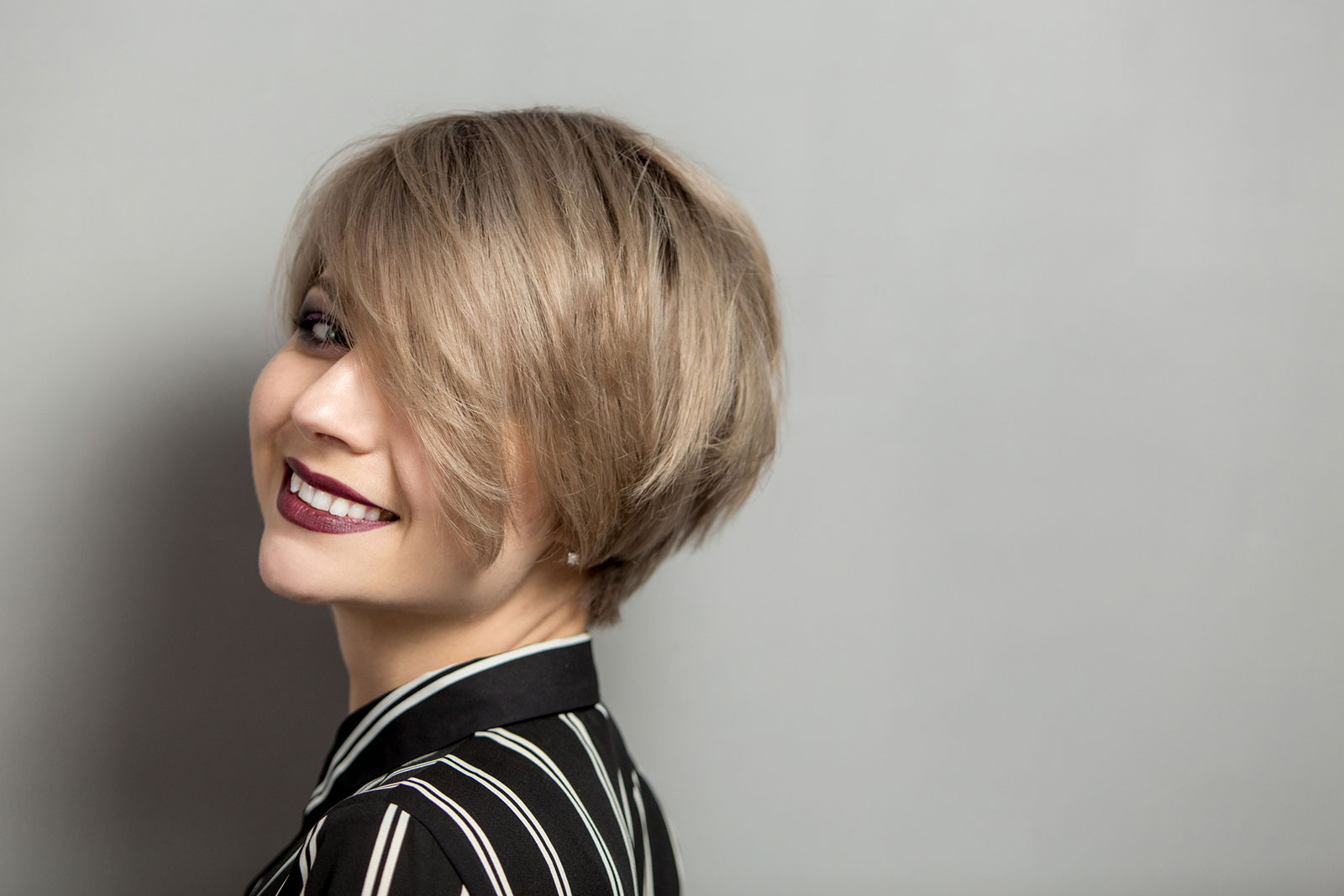 Ash blonde multi-layered asymmetric Short bob haircut