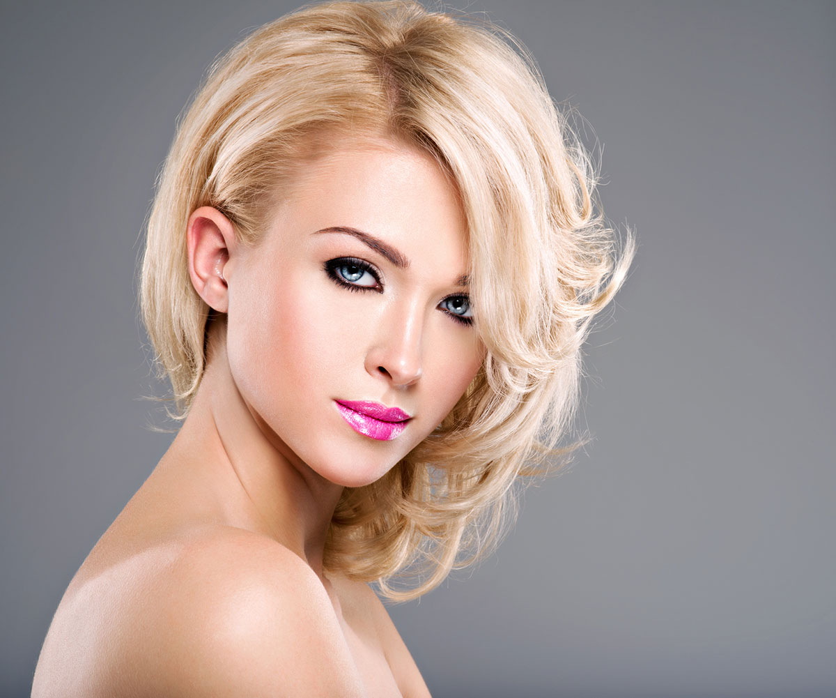 Feathered blonde with off centre parting Mid length hairstyle