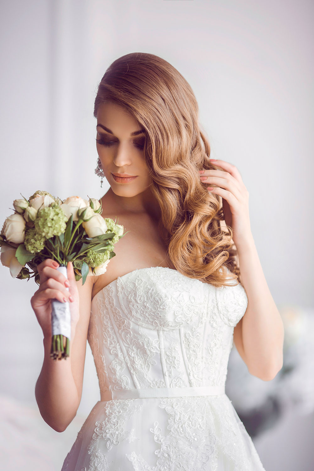 Long and wavy witha side parting Wedding hairstyle for ladies