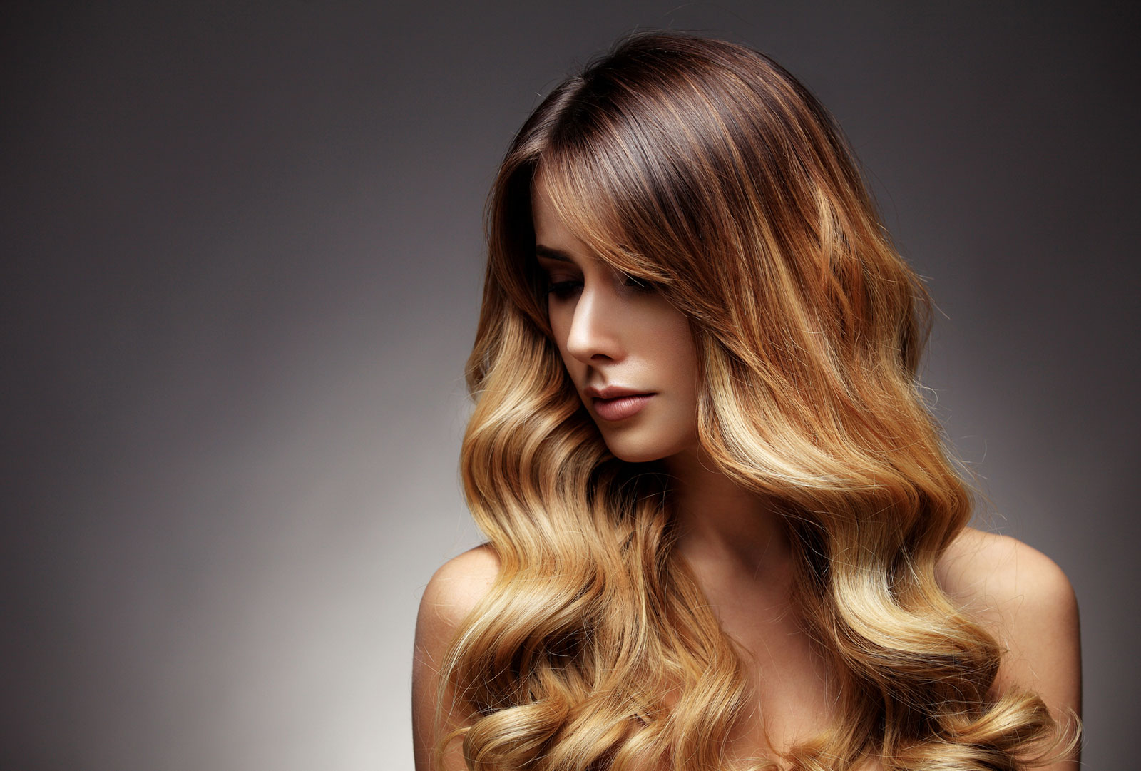 The brassy layered waves ombre brown to blonde